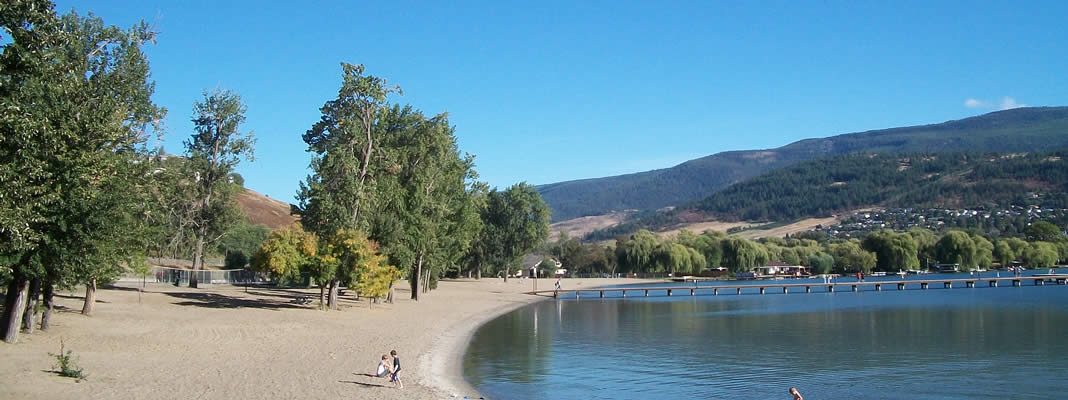 People enjoying scenic Kal Beach in Vernon BC